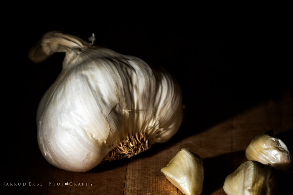 Garlic cloves shot in chiaroscuro style